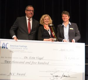 Dow Chemical's Erin Vogel (center) accepts the prestigious American Coatings AWARD from ACA's Steve Sides and Vencentz Network's Sonja Schulte.