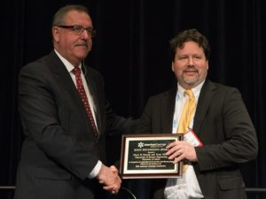Mark Soucek, University of Akron, accepts the Second Place Roon Award from Steve Sides.