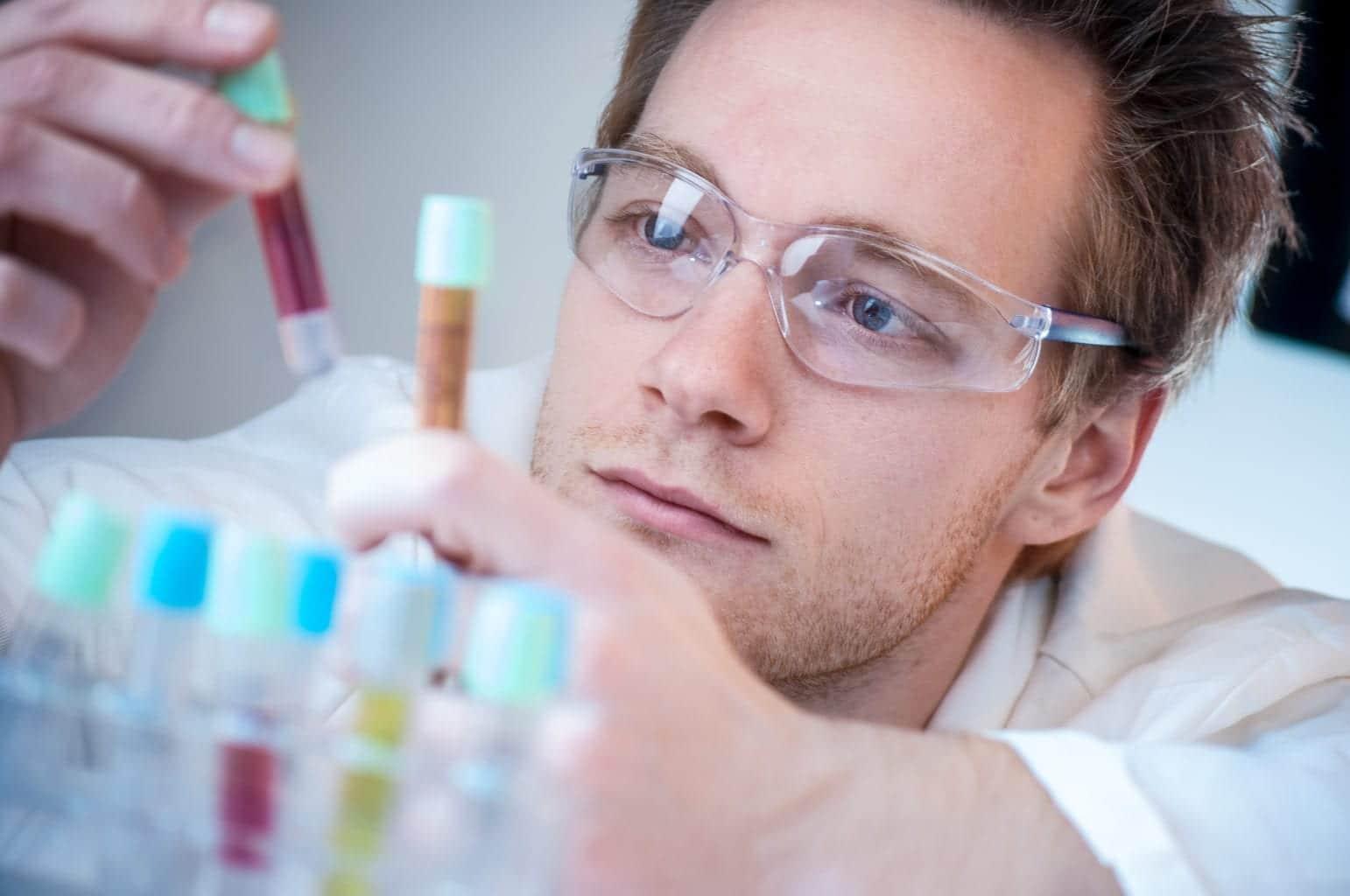 Scientist Comparing Results in his laboratory