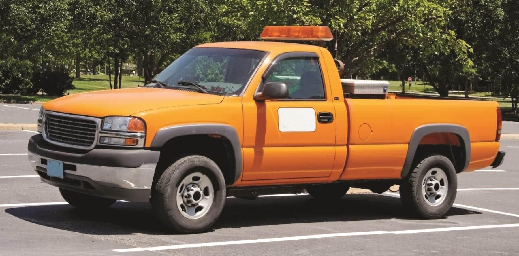 Orange department of transportation utility pickup truck.
