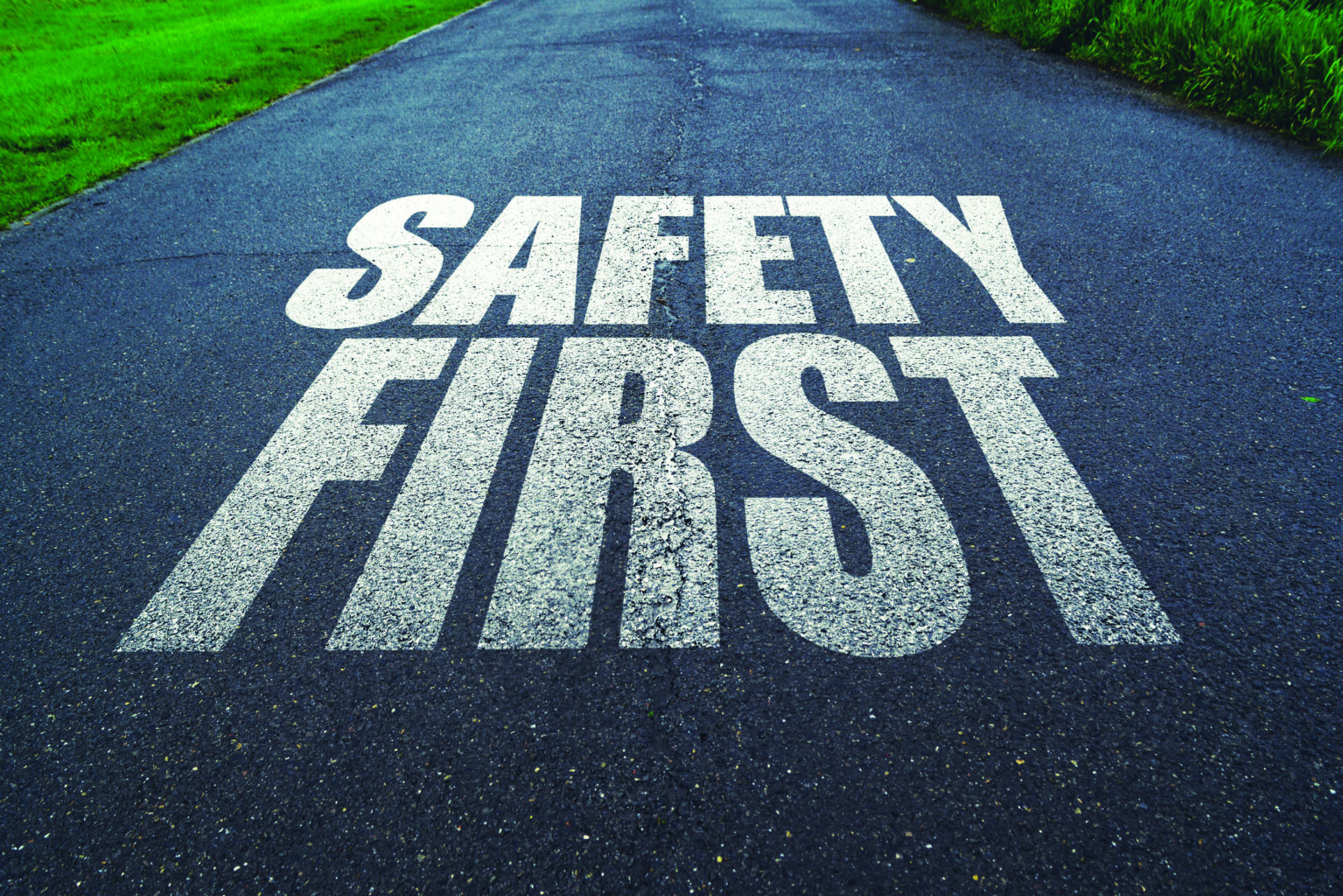 Safety first, message on the road. Concept of safe driving and preventing traffic accident.