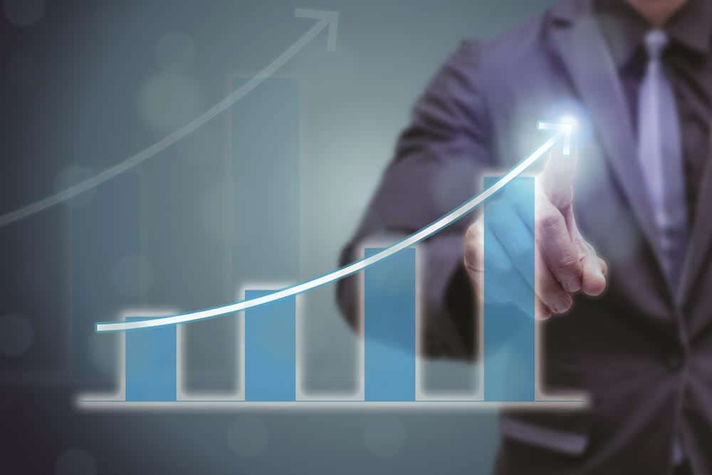 business man point hand on the top of arrow graph with high rate