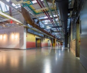 Commercial building floors can be refurbished into beautiful design elements by using the existing concrete floor rather than energy-intensive alternatives like tile or carpet