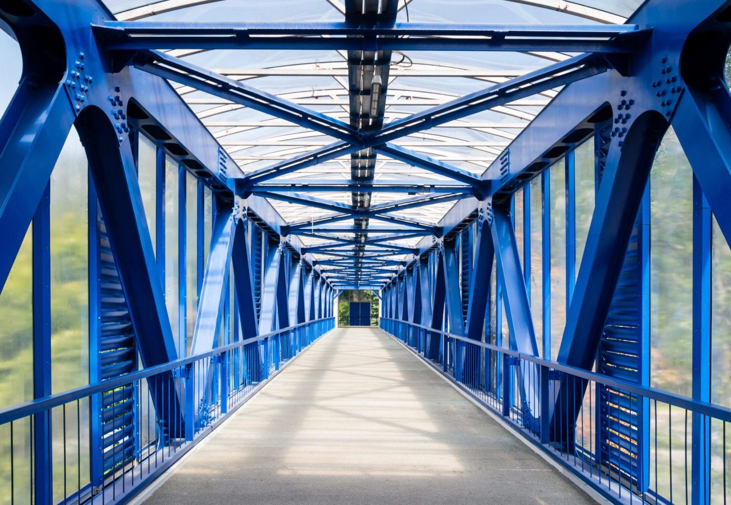 Interior of empty metallic elevated footbridge in the Moscow city.