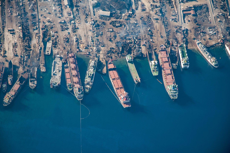 aerial view of a shipyard full of shipwrecks