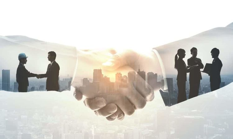 two professionals shake hands