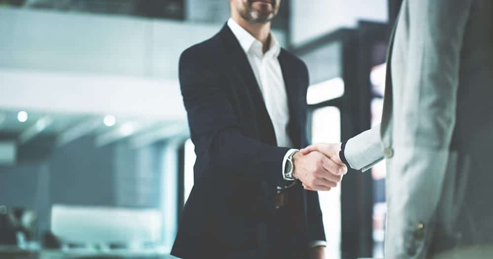 Closeup shot of two business people shaking hands in an office