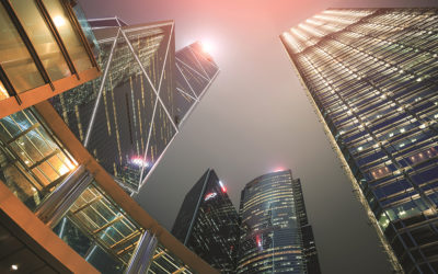 Perspective view of building in downtown hong kong city with light at night time.