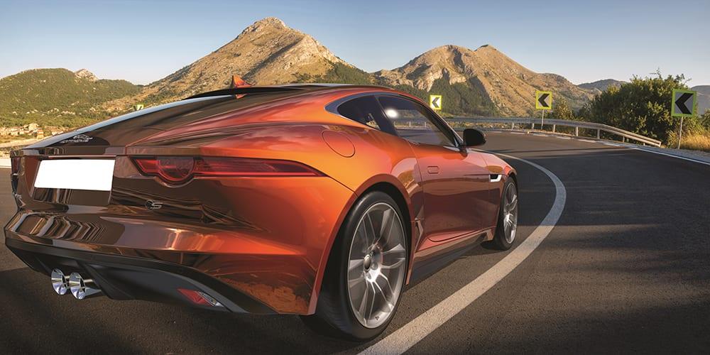 Jaguar F-Type on a winding mountain road - American ...