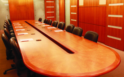 Conference room with large wooden table and leather chairs