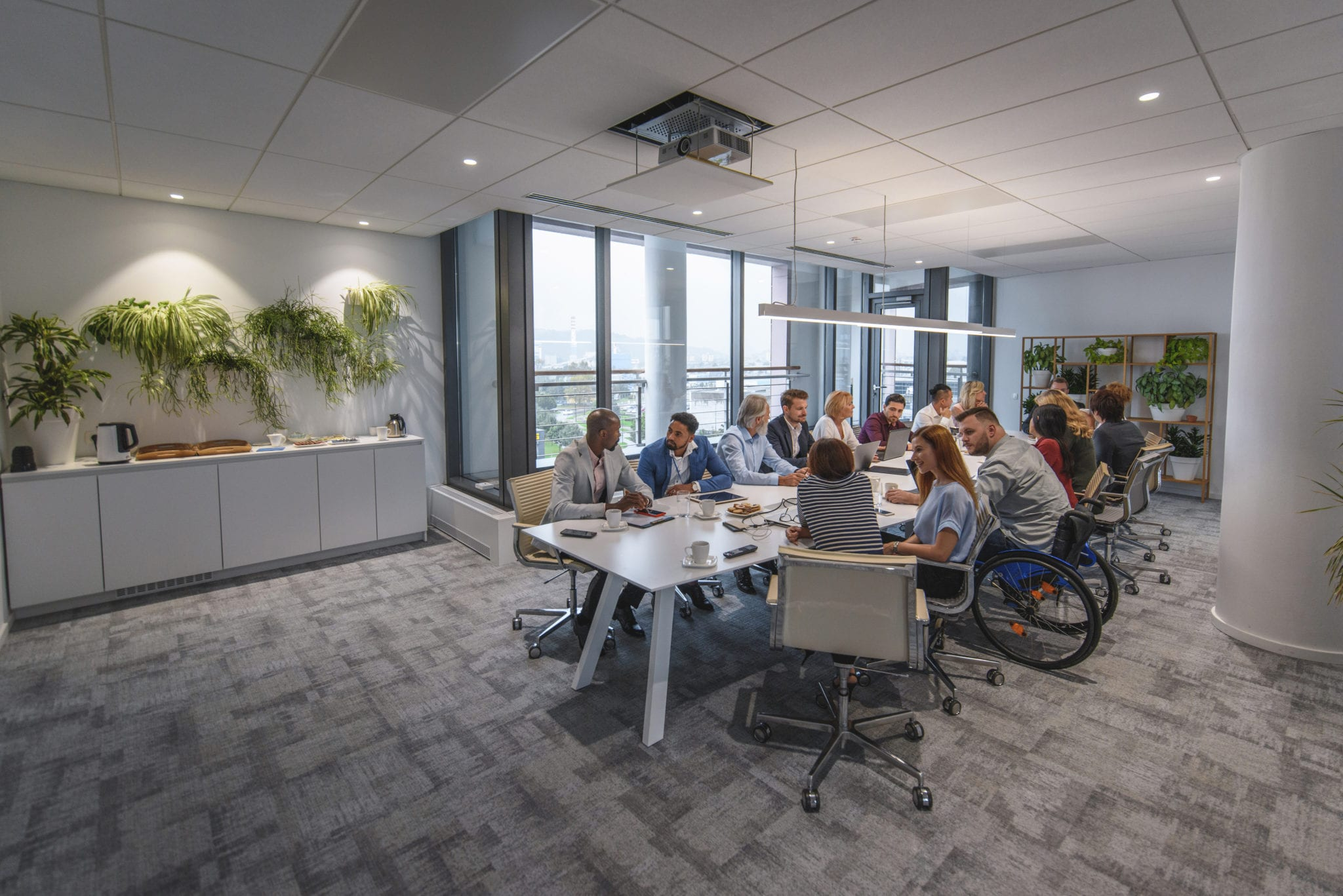 Executive Team Sitting at Conference Table in Board Room