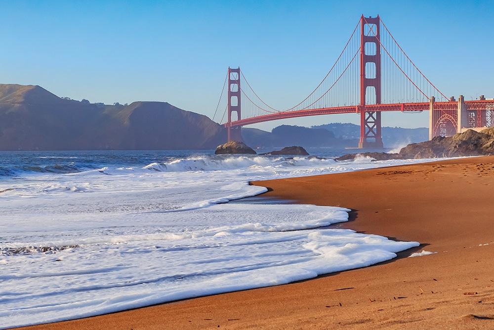 Golden Gate Bridge in San Francisco from Baker Beach at sunset
