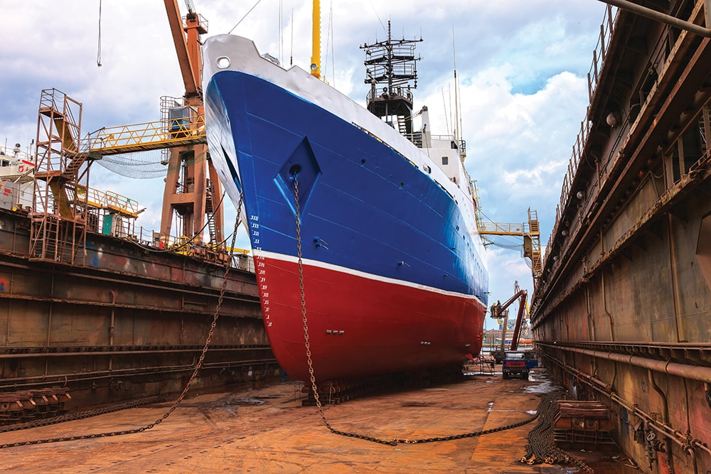 Cargo ship is being renovated in shipyard Gdansk, Poland.