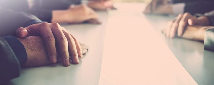 PICTURE OF HANDS ON TABLE