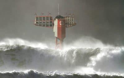 ocean waves running over a tower