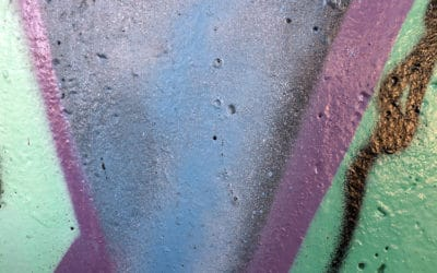 a colorful abstract image of paint on concrete