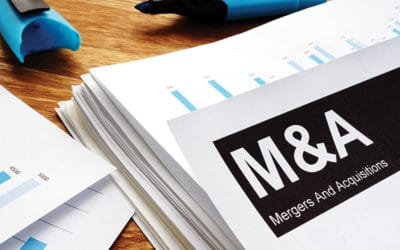 Documents about mergers and acquisitions m&a with a pen.
