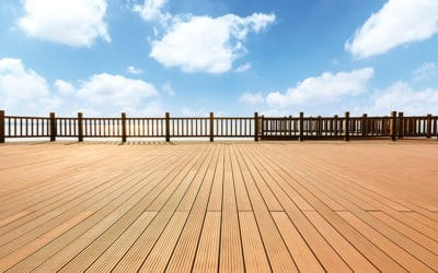 Lakeside wood floor platform and blue sky with white clouds